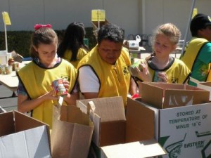 Mormon Helping Hands help prepare food supplies to be distributed to those in need.