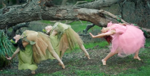 "Lindsey Stirling dancing with nymphs in the forest in her ""Lost Girls"" video"