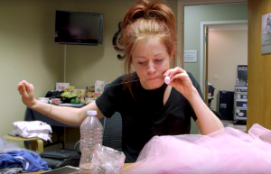 Lindsey Stirling fixing a costume