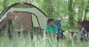 family camping in music video by Polynesian singer Junior Maile