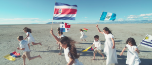 "Children carrying Latin American flags in Spanish cover of ""The Prayer"""