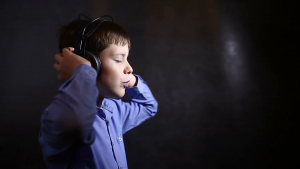 Boy listening to music.
